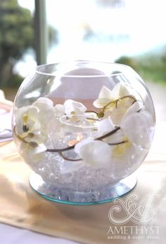 Beautiful wedding fishbowl centerpiece with white orchids and tealight candle Fish Bowl Centerpiece Wedding, Fishbowl Centerpiece, Gold Wedding Centerpieces, Wedding Table Decorations, Candle Centerpieces, Centrepieces, Centerpiece Ideas, Candles, Glass Fish Bowl