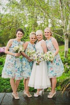 gorgeous bride Stacey and her vintage style bridesmaids in blue floral print | onefabday.com
