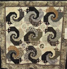 "Let Sleeping Cats Lie by Jane Chiles ~ The center spiral of these blocks is formed by the cats' tails all cozily curled up together. The center of this pattern is based on the traditional ""Snails Trail"" quilt pattern. The pattern, by Helene Knott, can be seen at Alderwood Quilts"