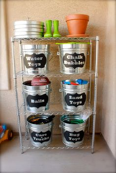 I did this with empty, (cleaned and washed, of course) plastic kitty litter buckets...gotta reuse em, u know; labeled BOOKS, BUBBLES, BLOCKS, etc Organizing Outside Toys