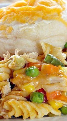 Chicken and Biscuit Casserole ~ Amazing... It is filled with veggies, noodles, and topped with biscuits and cheese.