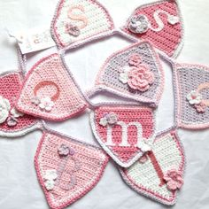 Beautiful personalised crochet buntings -  INSPIRATION. - Similar pattern @  http://attic24.typepad.com/weblog/2012/01/jolly-festive-bunting-ta-dah.html  and  http://www.redheart.com/free-patterns/welcome-baby-bunting  with PDF instructions @  http://www.redheart.com/files/patterns/pdf/LW3651.pdf