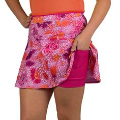 """SparkleSkirts SwingStyle DreamBlossom Watch your personal records bloom in this pretty pink medium-weight running skirt! Large berry-colored flowers mix with vibrant orange and purple in a soft batik design. Skip the hassle of holding your phone or adding a race belt! You'll find plenty of storage in two 5x5"""" side pockets and a 12"""" zippered waistband compartment. Say goodbye to chafing thanks to the magenta anti-ride undershorts, which feature a double-layered crotch gusset for added…"""