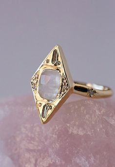 Envy Diamond Ring // Bohemian + Desert inspired boho ring from Free People by Sirciam Jewelry // Be the source of envy with this geometric gold ring featuring gorgeous shimmering diamonds and a moonstone accents.