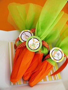 Wrap silverware for Easter dinner in orange napkins