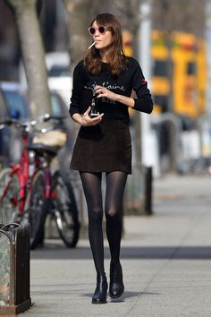 Alexa Chung Photos Photos - Alexa Chung seen out and about carrying a cigarette at Soho in New York City. - Alexa Chung Strolls Through SoHo