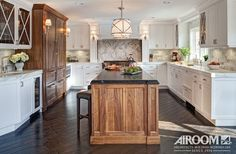 A returning client found a house with the perfect setting and asked us to turn it into the perfect home. A kitchen that contrasts walnut wood with white marble countertops also features restaurant-quality appliances.