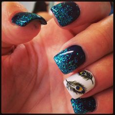 Rock star gel nails with peacock feather at nails by Kelly marble falls Texas