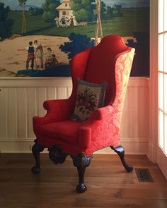 A favorite wing chair covered in red damask