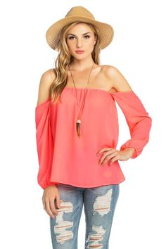The perfect top that goes with shorts or jeans! Our Give It A Whirl toip features an off-the-shoulder cut with elastic cuffed wrists. Available in Pink, Blue, Fuchsia, Coral, Hot Pink, or Black.