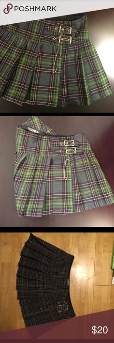 Lip Service Plaid miniskirt size M Lip Service Skirt, plaid with 2 buckles and pin. Fits more like a small/media and has hidden Velcro to adjust size! In great condition!!! Lip Service Skirts Mini