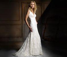 Shangri-La- Soft V neck ivory and mocha corded lace wedding dress with soft panelled fishtail skirt and ivory taffeta ribbon under bust trim.