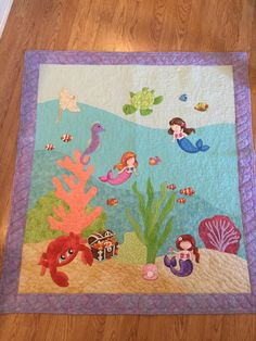 """Heidi used pre-printed fabrics to create this adorable underwater quilt for her four-month old granddaughter. Very cute, Heidi!     What a great reminder to """"always sea life's beauty!"""""""