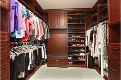 Luxurious walk in closet with plenty of stoage space