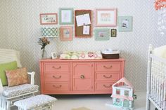 gray stenciled wall and coral painted dresser
