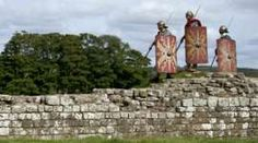 Re-enactors dressed as Roman soldiers on Hadrian's Wall