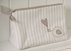 Neutral pouch with birdie by countrykitty, via Flickr