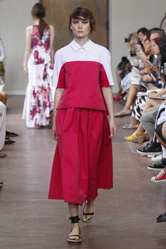 An inventive use of colour blocking makes this model at the@antoniomarrasshow look like she's been dipped in raspberry sorbet . Delicious. #MFW #SS15