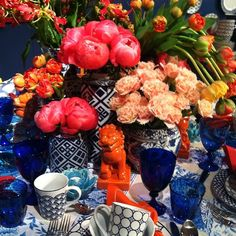 Cobalt glass, blue and white porcelain, bursting with blooms - nature's art with people's artistry!  (The Decorista)