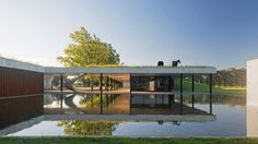 Polo stables features grassy roof for horses to graze and spectators to sit