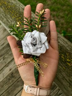 Made my first Christmas wedding boutonnière with pinecones, a feather and a sheet music paper flower. Gold, DIY