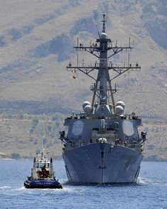 The guided-missile destroyer USS Cole (DDG 67) conducts a berth shift during a port visit to the Greek island of Crete.