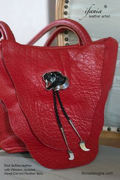 From New Mexico leather artist Ifania, custom regal red buffalo leather handbag coupled with hand carved jeweled panther bolo by Winston. ifaniadesigns.com