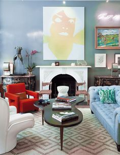 Enjoying this pop of colour - with the red chair, along with the collection of seating that has been partnered together. Fun, vibrant and lovable!