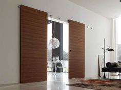 Раздвижные двери со скрытым рельсом. Купить раздвижные двери со скрытым механизмом крепления к стене