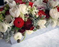 Strong and vibrant mixed with cool winter white creates and elegant and classy arrangement by Saipua — Soap and Flowers