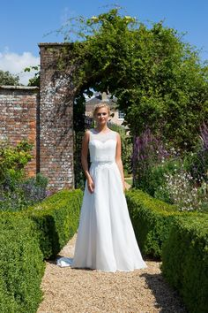 This sheer beaded blouson high neckline wedding dress features delicate beading, embellished ribbon belt and a soft A-line skirt. Wedding Dress Necklines, Wedding Dress Styles, Designer Wedding Dresses, Wedding Bride, Wedding Day, True Bride, Satin Color, Carlisle Cumbria, Bridal Gowns
