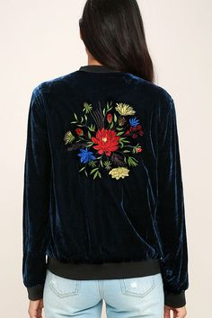 The What a Time to be Alive Navy Blue Embroidered Bomber Jacket is so trendy, we're at a loss for words! Soft velvet shapes this chic bomber jacket with a ribbed neckline, cuffs, and hem, while red, blue, yellow, and green floral embroidery blooms across the front and back. Silver front zipper.