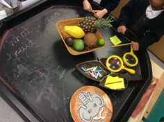 Handa's Surprise Investigation Table EYFS. Masks for the story from Twinkl.