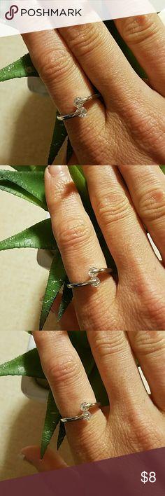 Elegant zircon crystal adjustable ring Silver plated zircon adjustable ring. Sizes 7-9. New and elegant Jewelry Rings