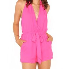"""Pink playsuit brand new without tags NWOT Super sexy pink romper, low-cut front and back, ties at neck, tie belt, and it has side slit pockets.  Material is 100% polyester, fully lined. Imported from Australia. Australian size M/10 Brand new but arrived without hang- tags. Waist measures 13.25 - 17.5"""" Hips measure 20.5"""" Waist to hem is 13.5"""" Size chart: Australia USA  XS/6         2  S/8           4  M/10         6  L/12          8  XL/14        10 CALS Other"""