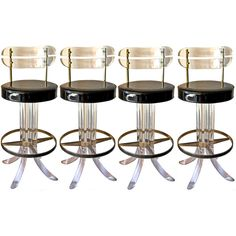 Set of 4 lucite and brass bar stools