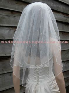 Bridal Veil with Sparkle accents, 2-tier elbow length, Very beautiful, Customize. $39.99, via Etsy.