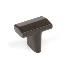 this matte black finish round cabinet knob with geomoetric design