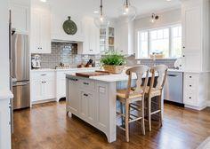 Kitchen featuring gray backsplash, white oak hardwood floors and white cabinets - Farinelli Construction