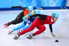 DAY 15:  (L to R) Freek van der Wart of the Netherlands, Denis Nikisha of Kazakhstan and Dajing Wu of China compete in the Short Track Men's 5000m Relay http://sports.yahoo.com/olympics
