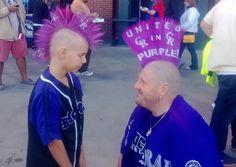 Fan with far-out Rockies mohawk has a mohawked mini-doppelganger.