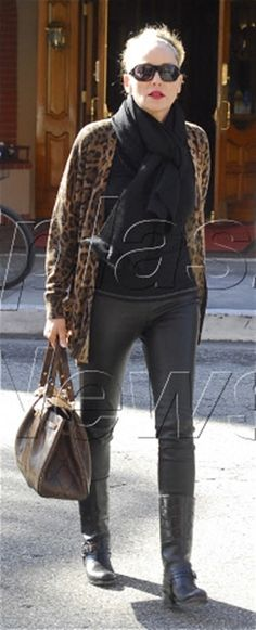Sharon Stone out in L.A. with her brown Salvatore Ferragamo python bag.  Haven't heard or seen anything about her quite awhile. She is looking good