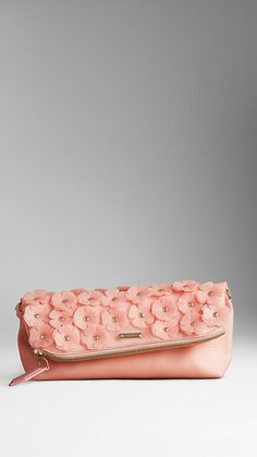 """Petal to the medal: Miranda Priestly once said, """"florals for spring? GROUNDBREAKING."""" But still, there is something whimsical about the hand-applied petals on this soft @Burberry  clutch that easily transitions into a shoulder bag with an accompanying slim shoulder strap."""