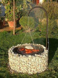 Pit with a hanging grill