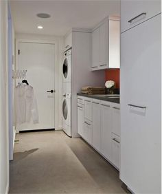 A stackable unit could be installed in the storage area of the basement.  This provides a very sleek look for laundry, sink, and storage. Contemporary (Modern, Retro) Laundry Room by Mary Jo Fiorella