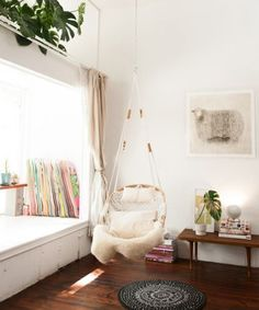 Rock the little one in a shabby chic hanging chair. Perfect for the nursery.