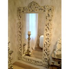 This stunning French mirror has swirling carved acanthus leaves and is finished in a distressed antique white patina, like it has been in the family for generations. By The French Bedroom Company