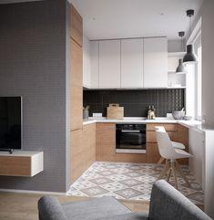 Małą kuchnię ozdobiono jasną wzorzystą podłogą. Meble z drewna wprowadzają do wnętra naturalność. Przy parapecie...