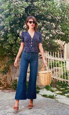 Jeanne Damas never fails to channel effortless Parisian chic. The kick flare jeans and wicker basket are the perfect pair this summer.