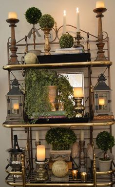 bakers rack with topiaries